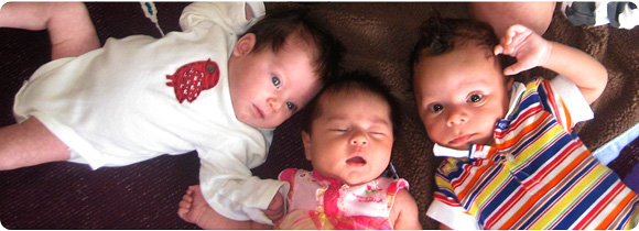 Three babies in pink